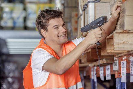worker scanning barcodes in warehouse