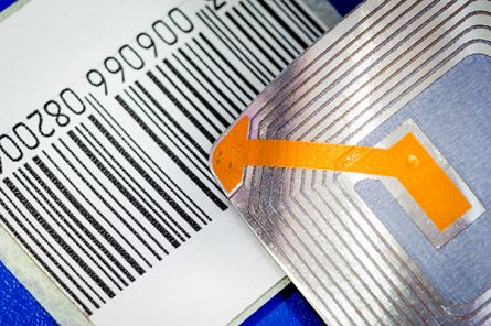 Close up of RFID tags and a code bar used for tracking and ident