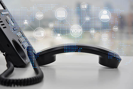 IP Phone double exposure with blue LED world map and business icon